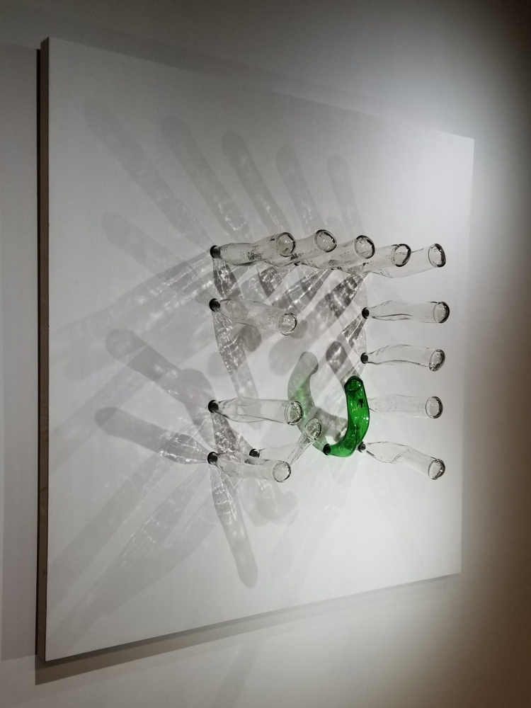 Glass sculpture with bottles