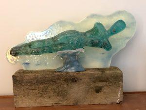 Glass sculpture of reclining woman