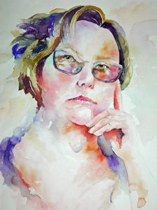 Watercolor painting of a woman's face